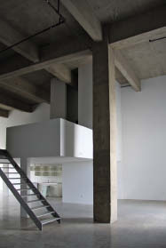The minimalist interior of one of the project's units. Dub Architects