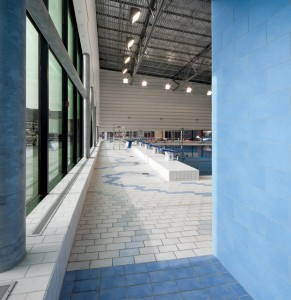 Blue tiles frame the entrance into the pool area.