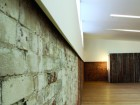 A carefully conceived ceiling-and-wall detail allows the original load-bearing masonry walls to remain exposed.