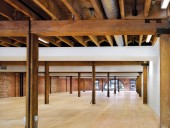 The restored office interior bears traces of the building's past life.