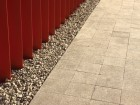 The red metal ribbons meet the ground plane by embedding themselves in gravel.