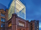 An elegant central glass tower now rises above the original 1912 structure as a result of modern engineering technology. Tom Arban