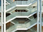 The ethereal butterfly stair is housed within the soaring lantern and connects to the museum's central atrium below. Tom Arban