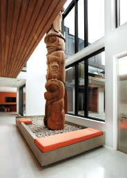 A custom-made totem pole in the main entrance is one example of the couple's extensive art collection.