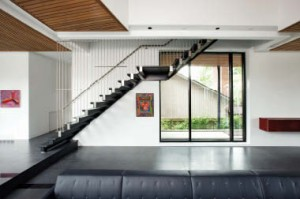 The stair leading up to the bedrooms is suspended by stainless steel rods.