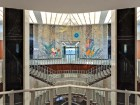 The interior of the main lobby--including its colourful mural by George Franklin Arbuckle--was restored to its original state.