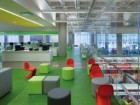 Colourful seating and flooring help define the children's reading area.