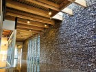 The interior material palette is comprised largely of stone and glulam wood elements. Steve Nagy