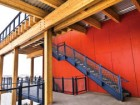 Brightly coloured building elements are used throughout the project to contrast the building with its context. Steve Nagy