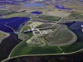 An aerial view illustrates how the new education centre is surrounded by wetlands. City of Calgary