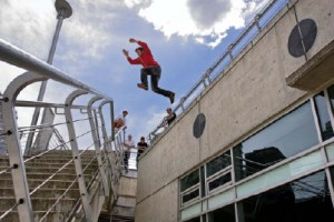 A youth performs aerial gymnastics off the railing at the Coal Harbour Community Centre in Vancouver---a building that was funded through a community amenity contribution. Christopher Grabowski