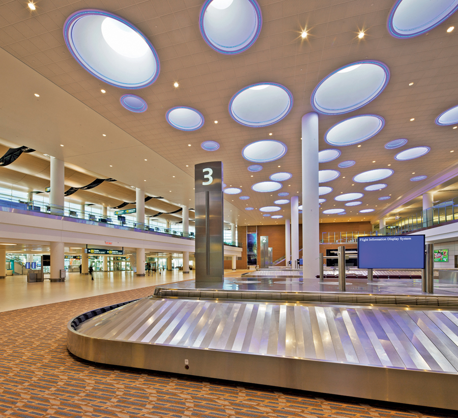 A lively--bubbly, in fact--ceiling over the luggage carousels brings light and whimsy to the project.