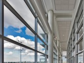 Brightly lit high-ceilinged corridors convey a sense of spaciousness to the airport facility.
