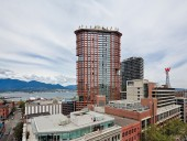 A contextual view of the redevelopment with North Vancouver and the mountains visible in the distance. Paul Warchol