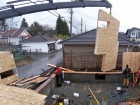 A construction crew installs pre-fabricated sections for one of LaneFab Design/Build's laneway houses. Lanefab Design/Build