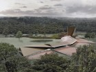 Plate-like roof forms above the low-lying building make for a dramatic statement within the landscape.