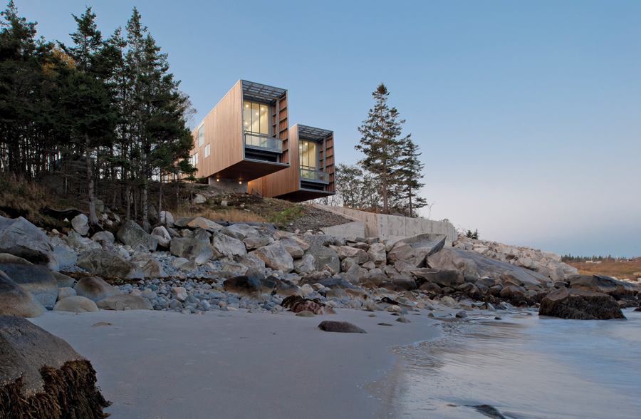 The house's two linked pavilions resemble a pair of binoculars looking out over the dramatic and awe-inspiring coastal landscape of the Atlantic Ocean.
