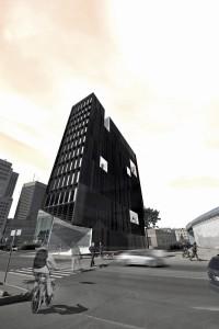The narrow sliver of a building strives to catalyze development.