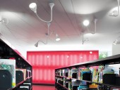 The bright fuchsia wall indicates the location of the children's reading area. Marc Cramer