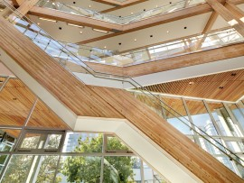 The atrium's clear-finished wood interior underscores the breathability and ecological awareness of the buildng.