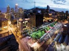 An aerial view of a crowd-packed Place des Festivals.