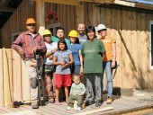 A construction team poses in front of a recently built home. Peter Papatie