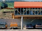 The timeless modernity of the Lignum Offices and Forestry Centre is clearly evident, especially when the vehicles date the image as vintage 1970s. Peter Cardew Architects