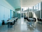 The learning commons in neutral shades of sky blue and grey. Ben Rahn