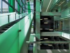 The University of Sherbrooke's signature green colour effectively provides a distinct identity and atmosphere to this central atrium space.