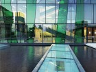 Colourful glazing provides much dynamism to this university complex.