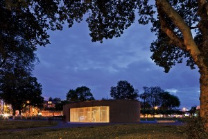 At night, the transparent and glowing pavilion serves as a beacon--and perhaps a watchful eye--in the park.