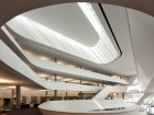 Traditional hand-finished plaster walls combined with an aggressively contemporary curvilinear design convey a certain elegance in this new library facility.