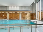 The light, bright and inviting therapy pool welcomes patients with a spa-like ambiance.