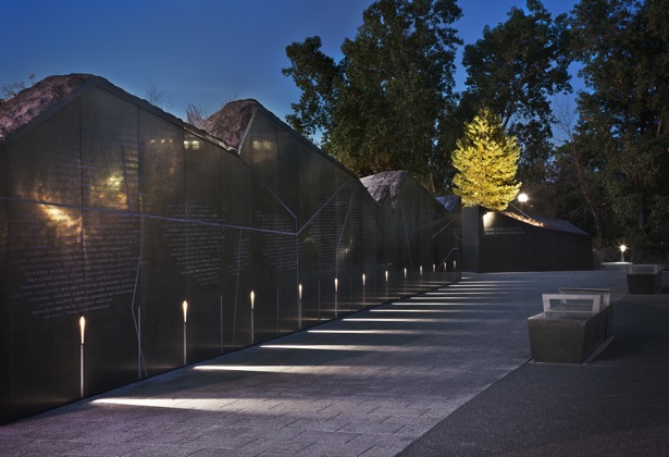 canadian firefighters memorial in ottawa. the granite name wall stands as an abstract interpretation of the canadian map and provinces - its surface carved with the names of fallen firefighters. photograph by steven evans.