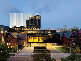 A view of the project from St. George Street showing the surrounding context of historic brick structures. The warm glow of the second-floor event space is a beacon to passersby. Tom Arban