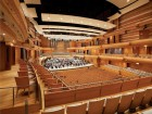 The interior of the performance hall envelops the audience in its warm expressive embrace and superior acoustics.