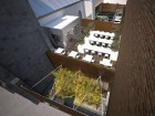 An aerial view of the enclosed roof terraces reveals ample seating and plantings for maximum comfort.