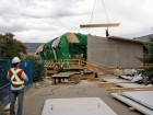 A cross-laminated timber panel is lifted into place.  McFarland Marceau Architects