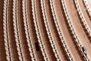 Beech-clad seats arc across the orchestra floor, contributing to warm acoustics and a cozy atmosphere.