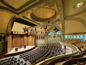 The sensitively restored interior of the Bourgie Concert Hall showcases a rare Canadian commission of Tiffany stained-glass windows.