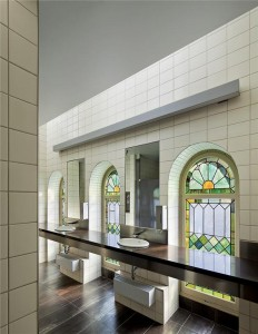 Old and new elements intersect in a second-floor washroom.