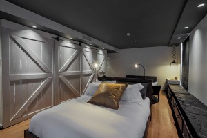 12 guest rooms comprise La Basse-cour and include barn-inspired doors.