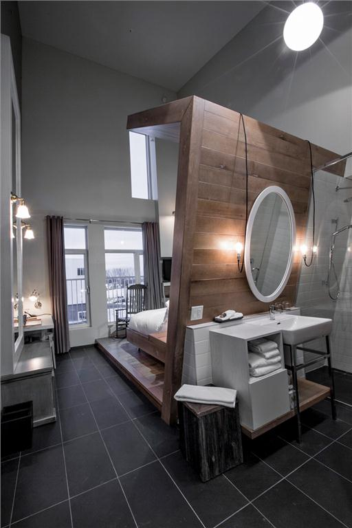 In the water-themed La Bergerie, bed platforms fold upwards to form partial washroom walls.