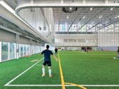 The fieldhouse offers an open, spacious atmosphere for practice during winter months.