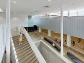 From the lobby, windows open onto a gymnasium associated with a small athletics centre that previously adjoined the stadium.