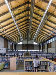 An elegant roof system creates a spacious library interior, reminiscent of local mills and heavy-timber barns.