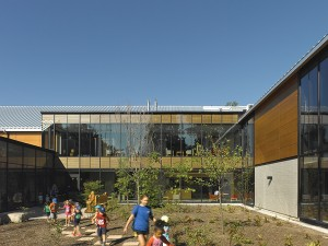 A new courtyard is framed by the three buildings.