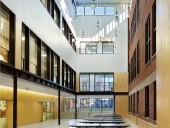 Montgomery Sisam Architects added new kindergartens and classrooms to the Maurice Cody Junior Public School, along with an atrium that brings fresh light and energy to the existing building. Shai Gil