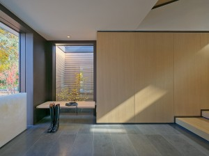 A purity of form, material and light is immediately apparent in the front foyer.