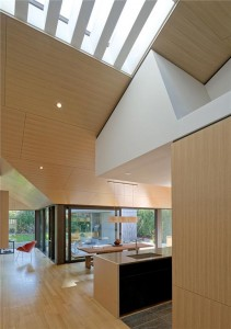 The pleasing complexity of the oak-sheathed ceiling planes is complemented by a skylight over the corridor.